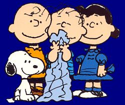 happiness is a warm blanket charlie brown linus writing a letter