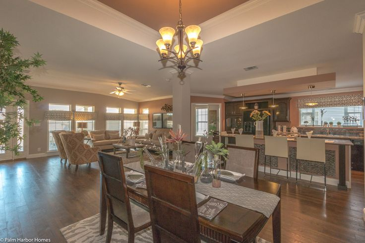 Standing behind the table in the dining room, you can see back into the entry area how open & light the La Belle IV is - 4 Bedrooms, 3 Baths, 2,847 Sq. Ft. triple wide manufactured home or modular home by Palm Harbor Homes