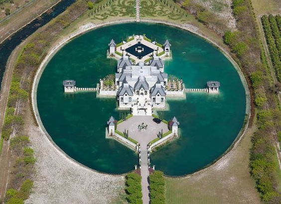 Yeah, perfect compound for a zombie Apocalypse.....after you blow the bridge, after all, zombies can't swim (I hope)      charles-sieger-castle-mansion-moat-miami1