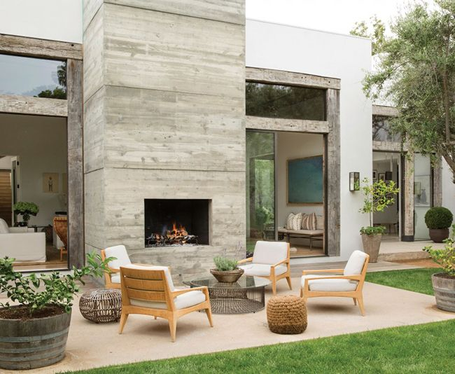 The concrete fireplace in Jenni Kayne's home is double-sided — allowing for making fires both inside and out.