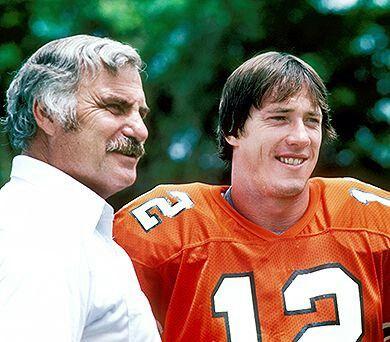 Coach Howard Schellenberger and Jim Kelly