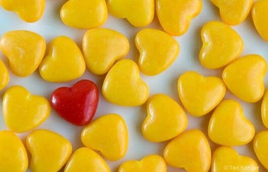 Even though shapes are similar, dominance is present in the one red heart due to color difference