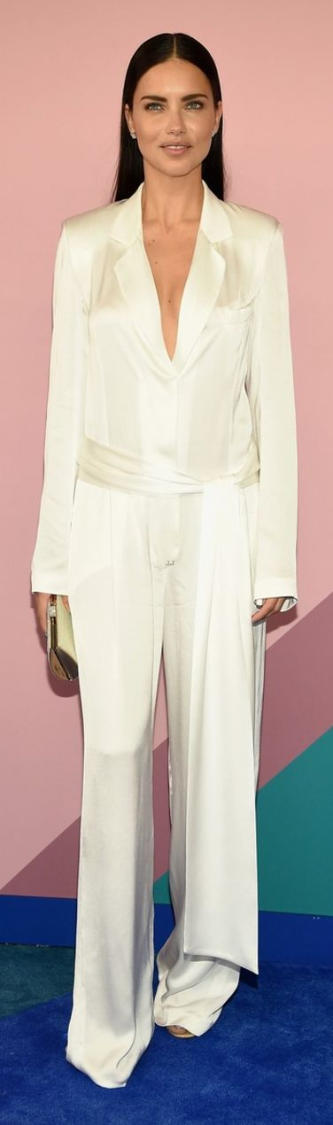 Who made Adriana Lima's white jumpsuit?