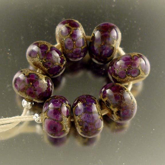 Purple Rose Organics, Handmade Lampwork Bead Set SRA. $20.00, via Etsy.