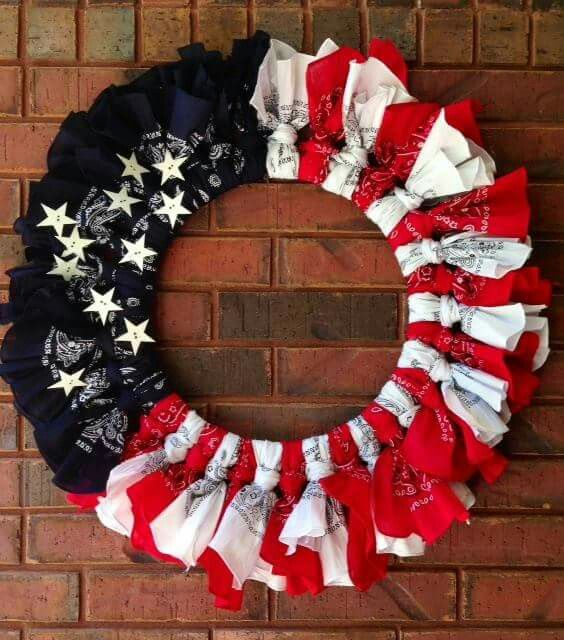 Here's what you will need: 18 inch wire floral wreath, 6 Red bandanas, 6 White bandanas, 6 Blue bandanas and some stars, mine are metal. Cut each bandana in half, tie over metal frame in sections. Hot glue stars.