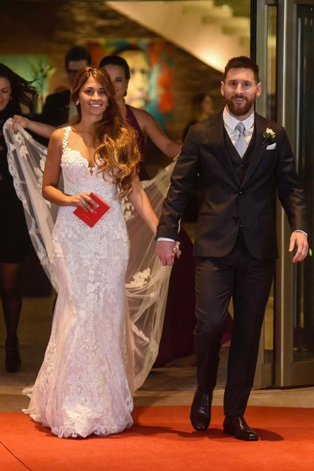 Lionel Messi marries his childhood sweetheart Antonella Roccuzzo in a Rosa Clara fit and flare wedding dress. #lionelmessi #wedding
