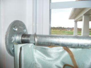 Inside mount, galvanized pipe cafe curtain rod - cool!