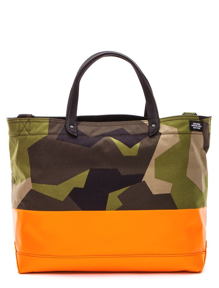 Jack Spade Camo Dipped Tote - Camo is meant to blend in, but this Jack Spade bag certainly stands out. The bold interpretation of camo is contrasted with a fiery orange waxwear dip. Die-cast Jack Spade hardware throughout. Zip top to protect the contents of the tote. Adjustable, removable shoulder strap. Canvas lined interior with zipped pocket.