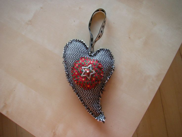 Heart made of fabric scraps , a bit filling, ribbon and a little hairpin with glitterstar