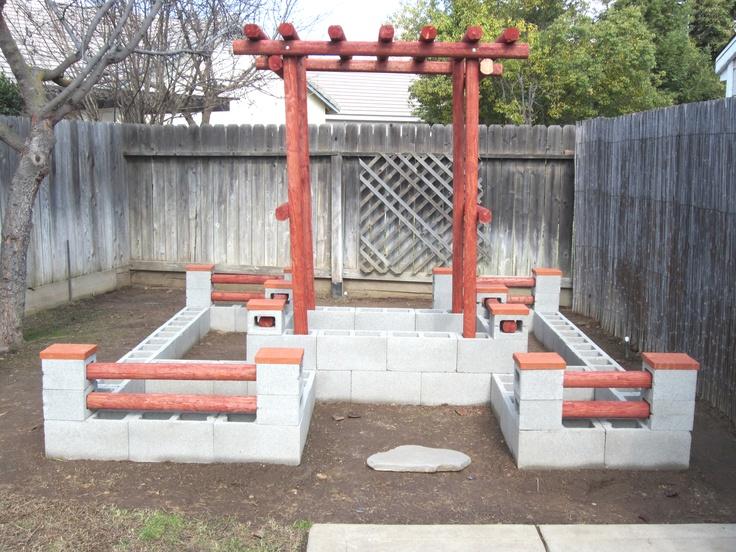 Our new Log Castle Raised Garden. Our twist on a concrete block garden.