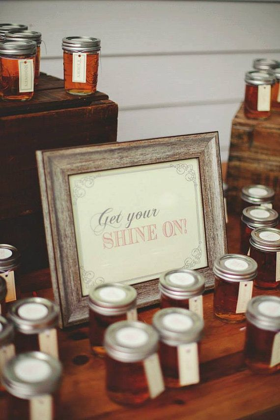 Southern Wedding Signage. This bride and groom gave away moonshine to guests as party favors. 'Get Your Shine On.'