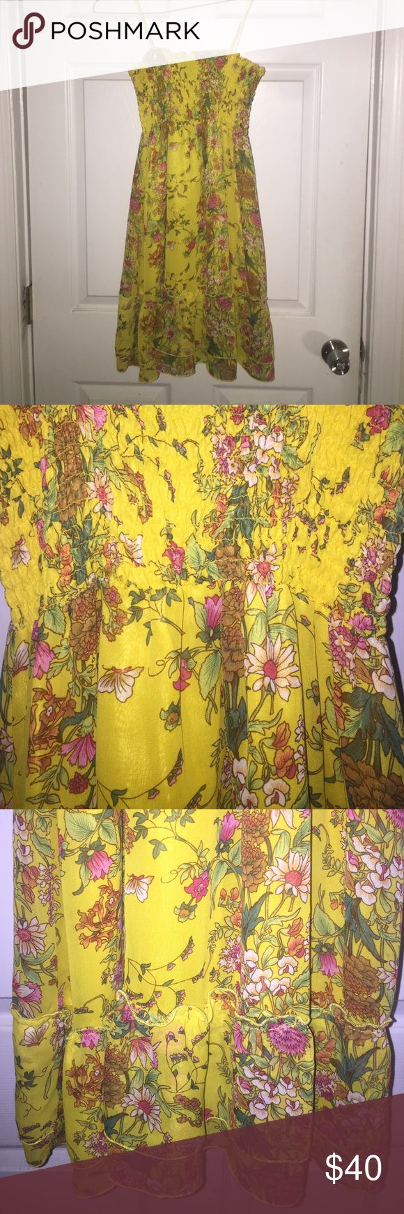 Yellow Floral Dress Yellow Floral Dress with Bandeau top and Ruffle Detailing at the Hem. Back and Front are Identical. Dresses Mini