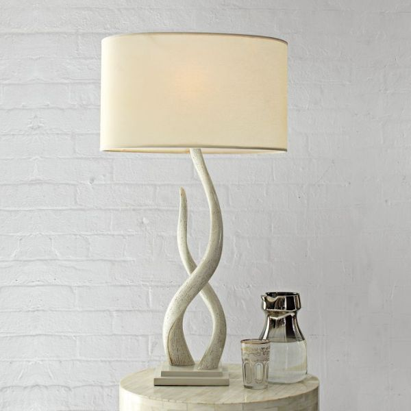 We have these kudu lamps from @west elm and they are great! Love the elegant curves!