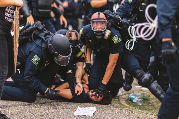"""They """"started charging into the crowd and tackling people,"""" said Max Geller, who was injured and arrested by cops"""