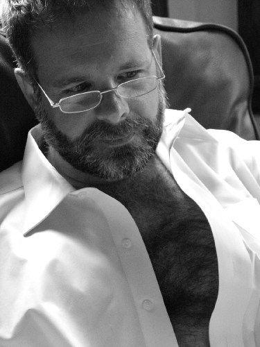 Reading glasses, crisp white shirt, fuzzy daddy rug.