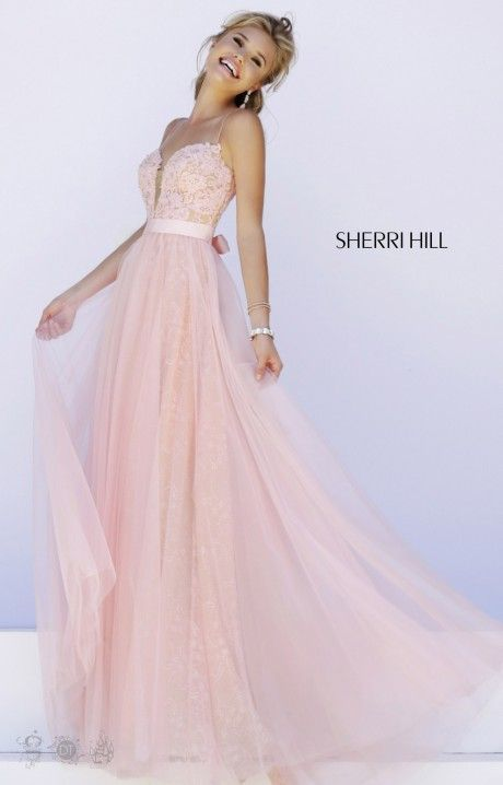 Sherri Hill 32229 is a sexy yet sweet formal dress that we can't get enough of ! Designed with a girlie style, this dress has skinny spaghetti straps and a deep V neckline embellished with delicate lace. A sheer mesh modesty panel covers cleavage in the front as well as the deep V in the back. Filled with layers of tulle and lace, this flirty skirt is great for prom and so many other formal events!