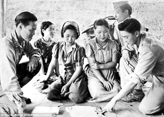Many 'comfort women' were given repeated injections of the syphilis treatment compound 606, which left many of them unable to have children. Pictured: Captured women in Myitkyina, Burma, in August 1944