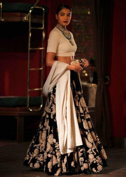 Model in black lehnga for sabyasachi during Indian couture week July 2014