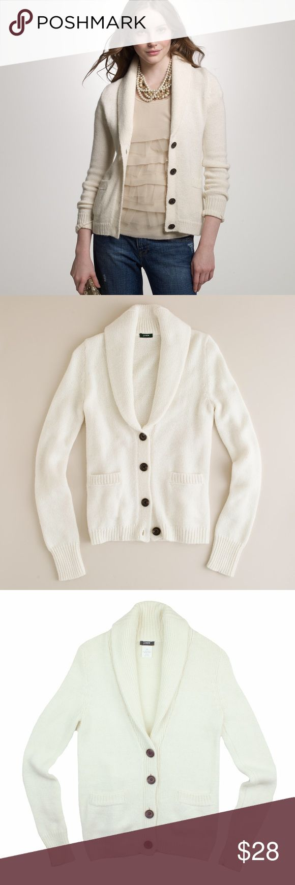 "JCREW Ivory Nonno Shawl Collar Cardigan Sweater Great condition! This ivory nonno shawl collar Cardigan sweater from JCREW features button closures, front pockets and a shawl collar neckline. Made of an alpaca blend. Measures: bust: 34"", total length: 23"", sleeves: 26"" J. Crew Sweaters Cardigans"