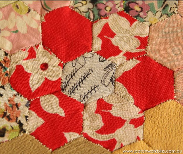 A hexagon block made in the 1940's by Lil Evans, Casino NSW. The fabrics are crepe de chine dress fabric.