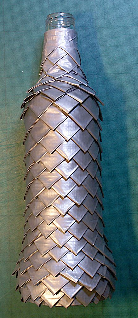 Dragon scales made out of duct tape. The instructions are for a bottle cover, but could be very useful for cosplay!