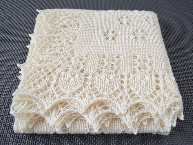 """This nature-inspired square shawl is worked in all-over lace. The style of the lace motifs is based on traditional Estonian techniques. The main square part of the shawl has a simple, yet charming floral design which creates a """"glade."""" The edge worked around the main square represents a """"forest.""""The pattern includes written (or row-by-row) instructions, charts, tutorials and provides a clear guidance throughout the entire process.IMPORTANT!Recommended weight of yarn is light fingeri..."""