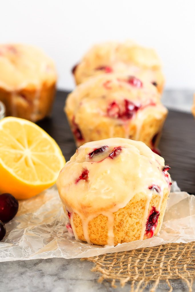Glazed Lemon Cranberry Muffins - These glazed lemon cranberry muffins are light and fluffy with the tart, fresh cranberries complimenting the sweet lemon glaze perfectly!