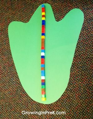 Dinosaur Theme ~ measuring foot prints add post-it to encourage children to record how big the footprint is.