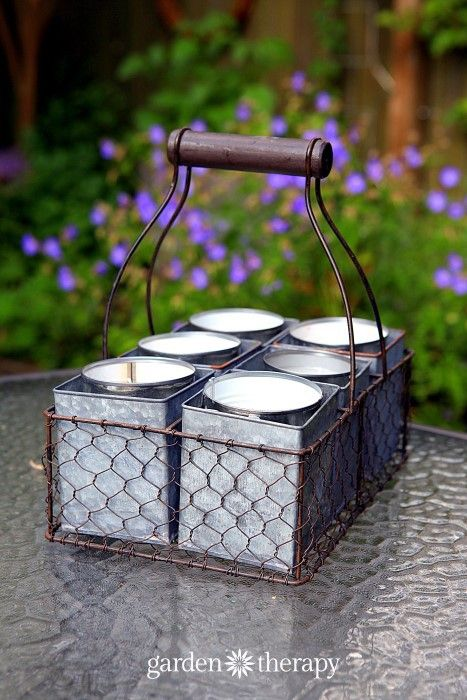 """""""DIY Citronella Candles make them in soup cans and display in an antique milk crate - six burning candles will make sure there is not a mosquito to be found!"""""""