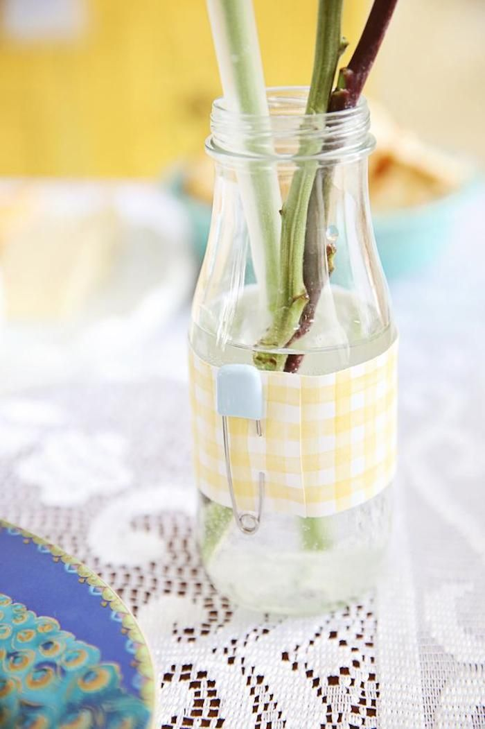 Love this diaper pin drink/vase wrapper in this Oh Baby + Beauty In Small Things Themed Baby Shower via Kara's Party Ideas | Cake, cupcakes, desserts, games, activities, and MORE! #gewnderneutral #babyshower #partydecor #partyideas