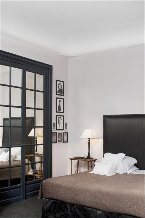 An inspirational image from Farrow and Ball A bedroom with walls in Great White Estate Emulsion, doors in Railings Estate Eggshell and ceiling in Pointing Estate Emulsion