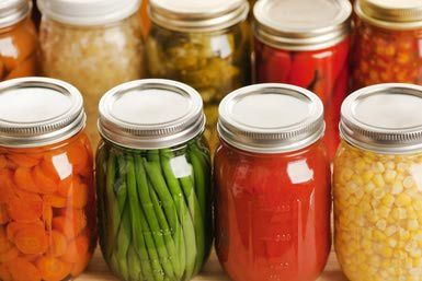 Rows of Fall Harvest Vegetable Food in Home Canning Jars - YinYang/E+/Getty Images