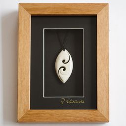 Maori Art Double Koru framed Bone Carving.  Exquisitely carved and beautifully framed. Gorgeous. http://www.newzealandshowcase.com/productdetails.cfm/productid/432