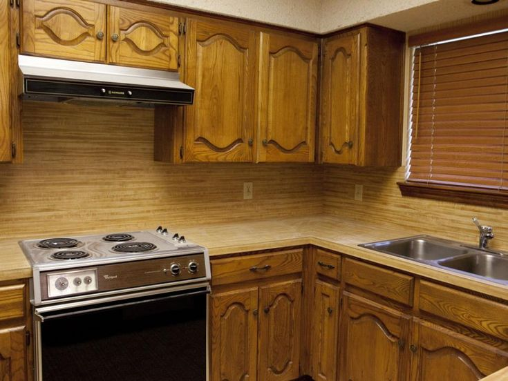 KITCHEN, BEFORE: The kitchen was saddled with drab wood cabinets and surfaces, and the original appliances were approaching retirement age.