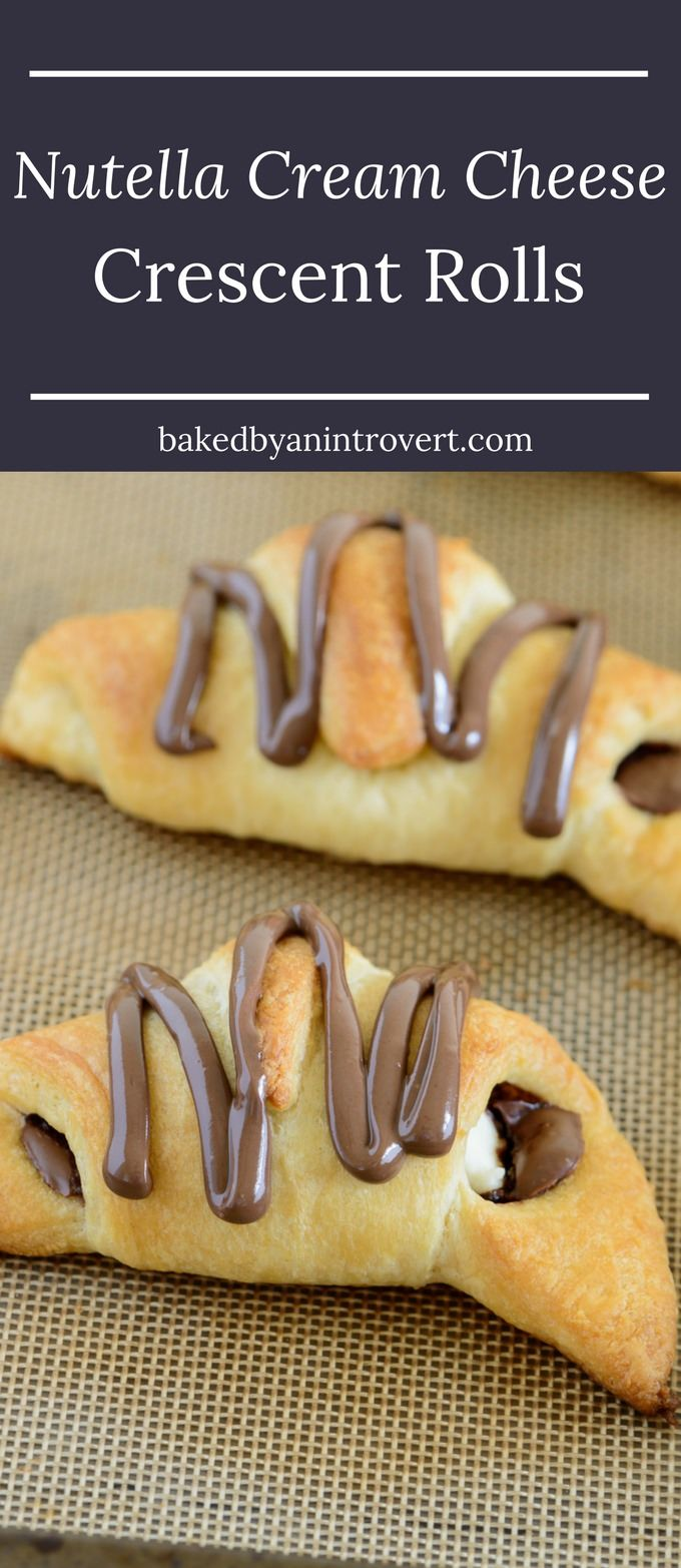 These Nutella cream cheese crescent rolls could not be easier. Filled with rich Nutella and chunks of cream cheese, topped with more Nutella, and only take 20 minutes to make! via @introvertbaker