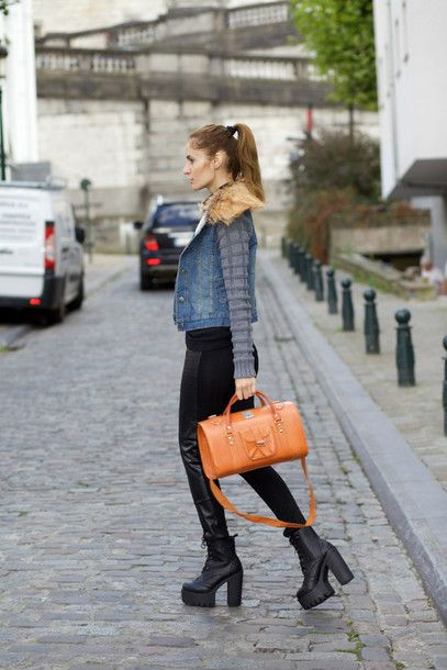 Pair your weekend outfit with leather pants, chunky platform shoes, orange handbag and denim jacket for a finished streetstyle look.