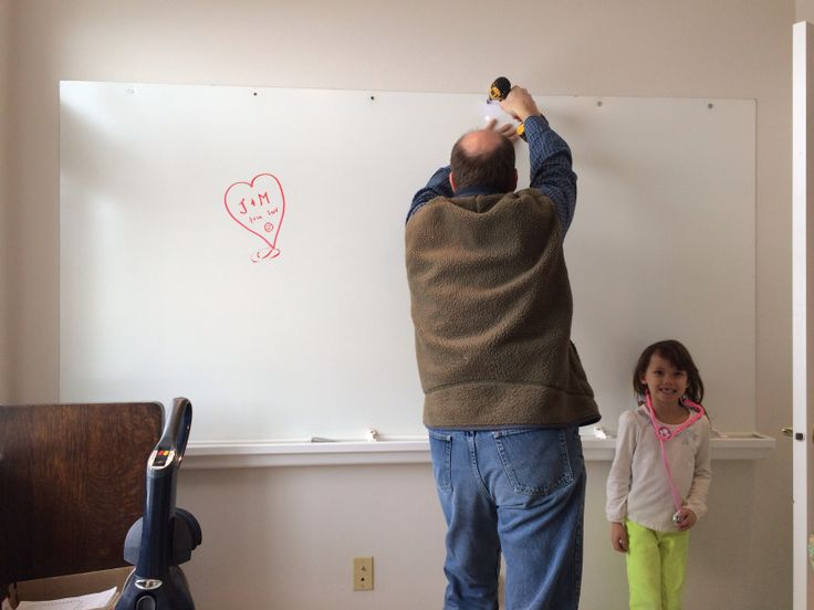 Awesome thrifty white board $13 & plastic gutter $5 from Home Depot. Home school room.