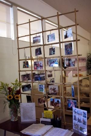 Reggio classroom with family photos at sign in, awesome see through partition idea as well by proteamundi