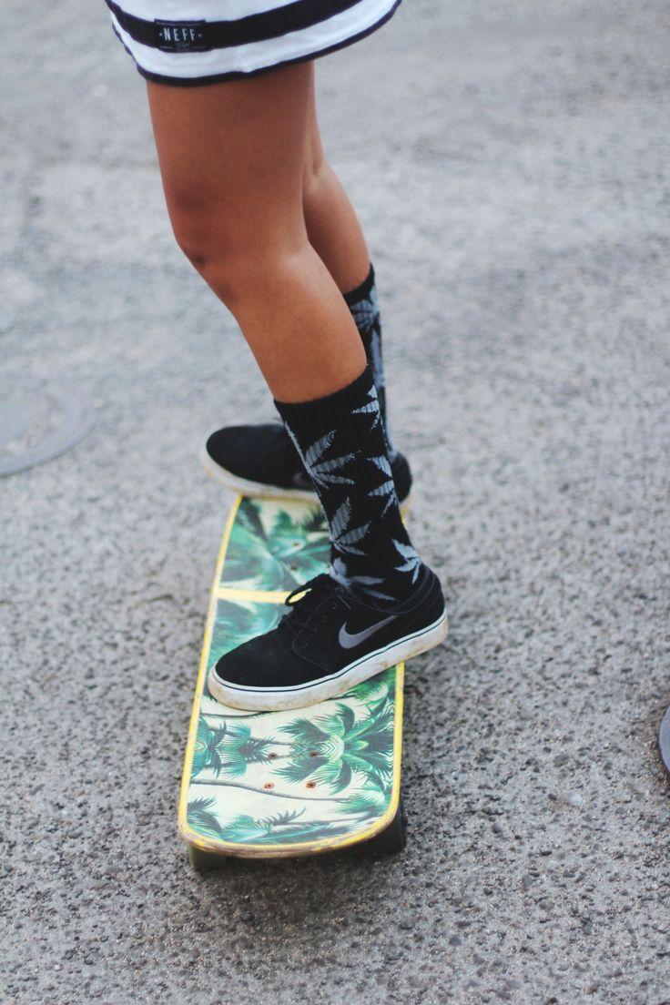 Tropical skate style in Honolulu, Oahu, Hawaii. Pineapple-themed deck with long socks. Nike black canvas shoes.