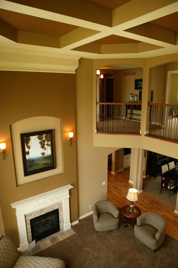 Open living area with two story ceiling lovely house for Open floor house plans two story
