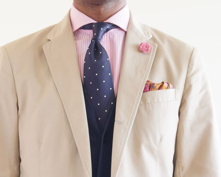 Beige jacket, pink gingham shirt, navy tie with white pin dots, navy pants