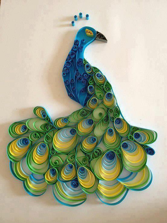 Paper quilling peacock Learn the Technique of Paper Quilling! http://www.thediydish.com/2010/12/day-2-learn-the-technique-of-paper-quilling/ video tutorial http://www.youtube.com/watch?v=ShpS9HUEYPQ
