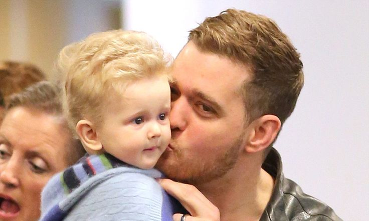 Buble kisses his son noah as they arrive in vancouver michael buble