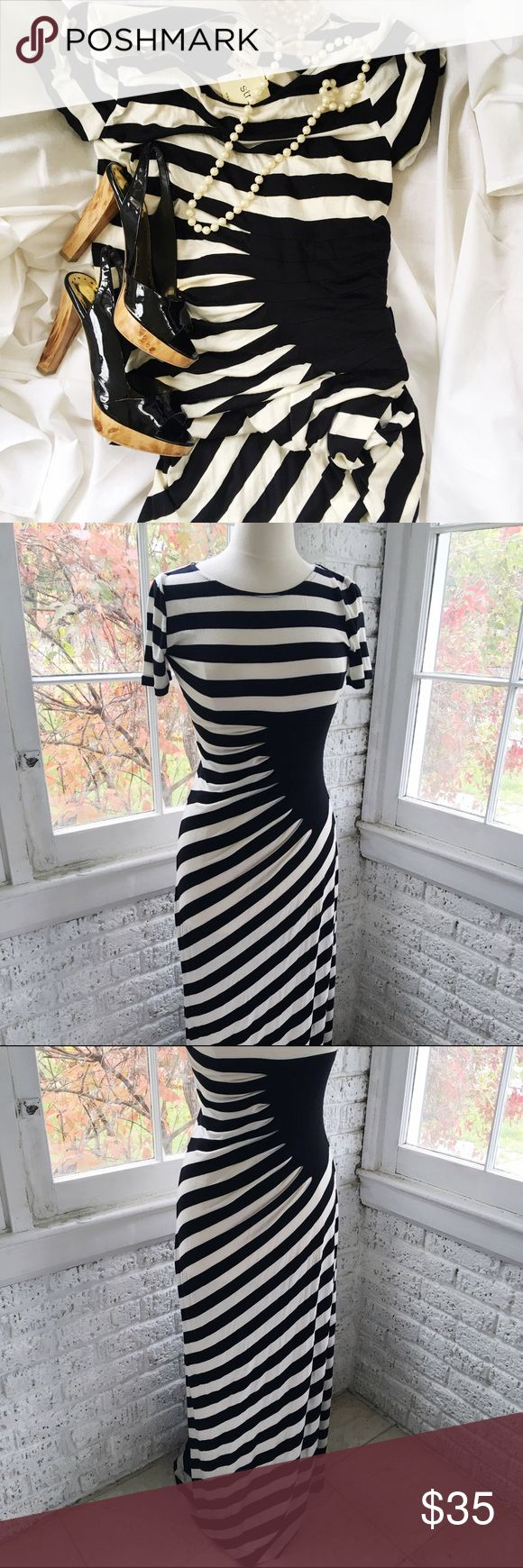 Eci Black and White short sleeve maxi dress NWT Great style and Super flattering black and white striped floor length maxi dress. Size Medium. For reference mannequin has a 38 inch bust. 96% rayon 4% spandex for that jersey fabric feel. ECI Dresses Maxi