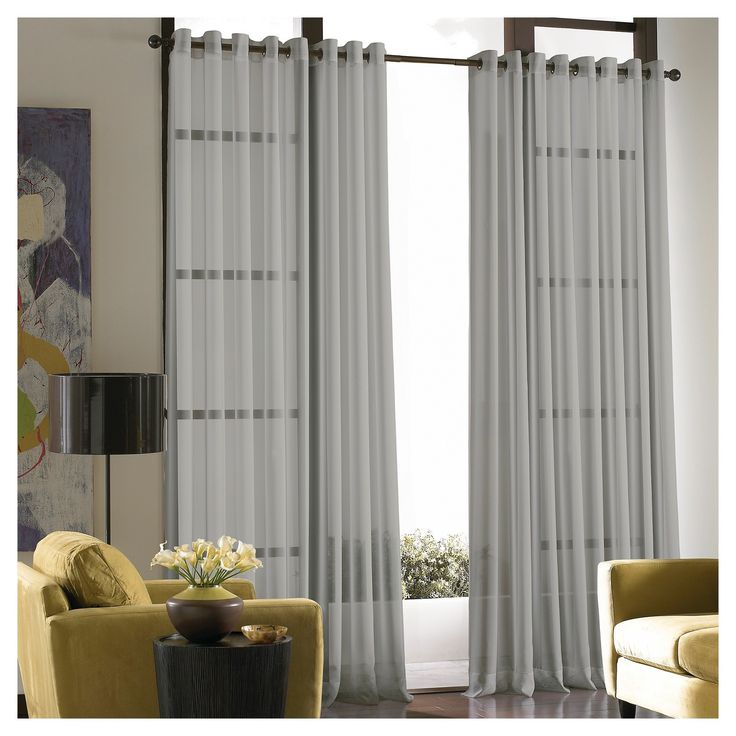 The combination of sheer weave and gorgeous drape make the Curtainworks Soho Curtain Panel perfect for adding just a hint of texture to your window treatment. The sheer curtain's easy-to-install grommet top slides on a curtain rod with just a touch; the modern curtain has high-contrast hardware and minimalist lines to sync with your contemporary decor.