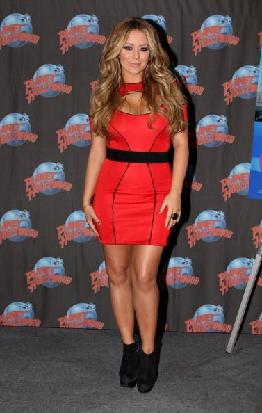 Aubrey O'Day promotes her Oxygen Network series 'All About Aubrey' as she visits Planet Hollywood Times Square on March 7 2011 in New York City