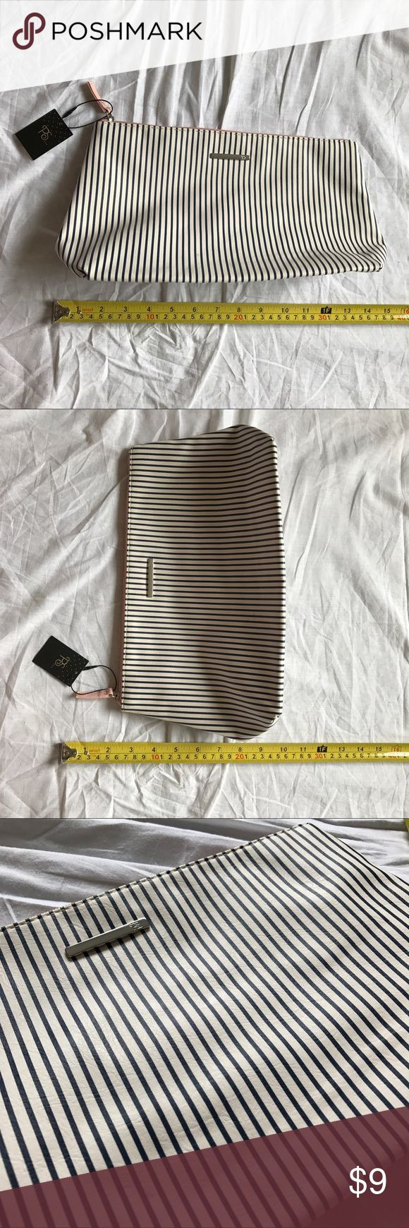 """Primark Stripes Pouch Brand new with tags. Great condition. L 1' H 7.5"""" W 4"""" Faux leather on the outside and pink lining on the inside. This listing is only for the pouch. Other items on this listing is not for sale. primark Makeup"""
