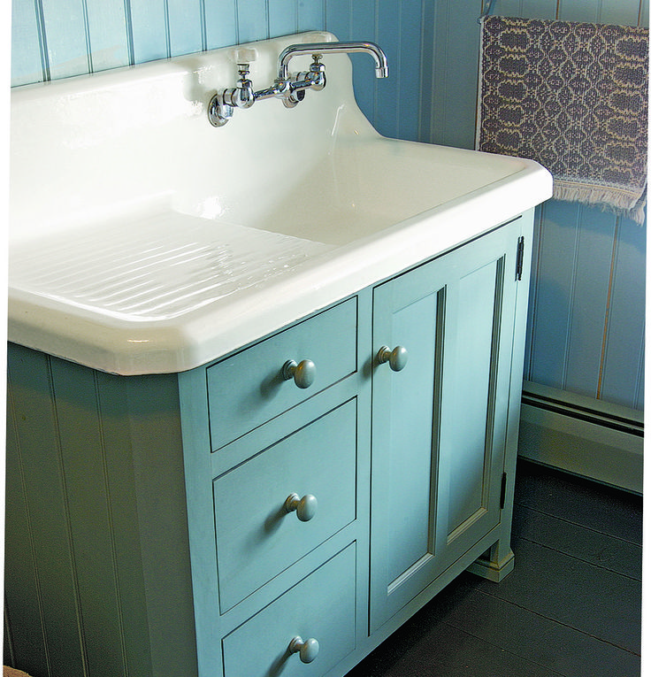 A charming bath cabinet made to fit the old sink found in an 1830 house's basement.