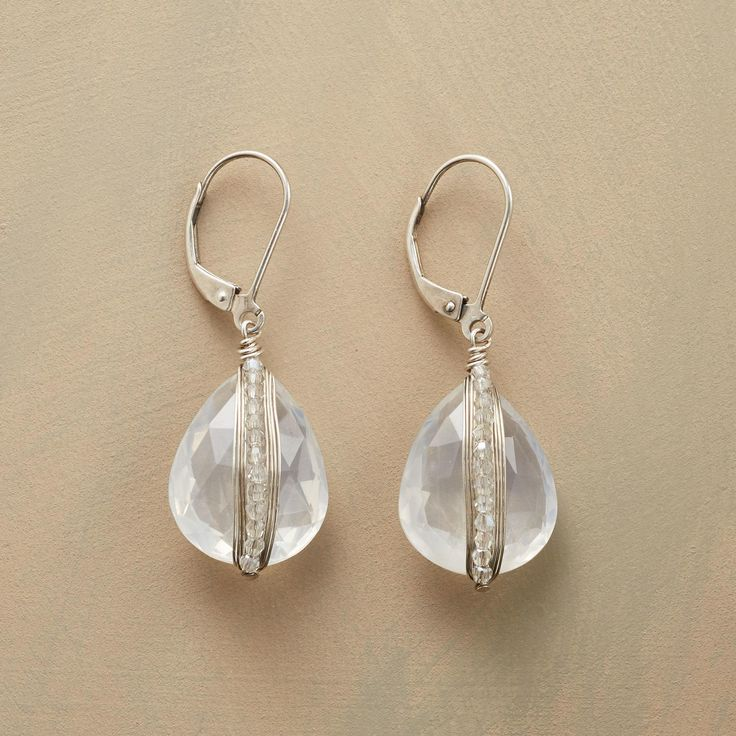 """CLEAR VIEW EARRINGS--Wraparound sterling silver wire and Swarovski crystals add Dana Kellin's telltale spark to prominent ice quartz teardrops. Handmade in USA with lever back wires. 1-1/2""""L."""