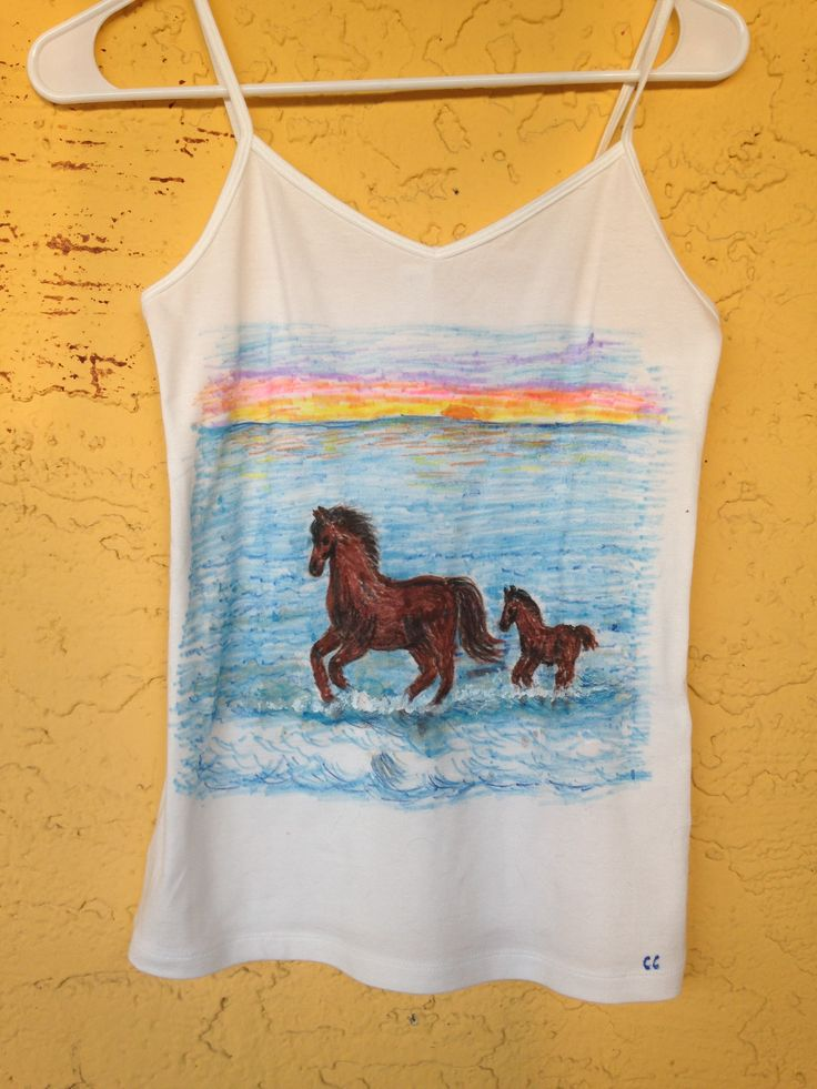 Ladies size medium white cami tank top features a horse and her foal running in the beautiful ocean at sunset. We design custom made clothing by hand using non toxic fabric markers, if you want your pets, nature or a specific design or scene drawn on a T-shirt, Tank Top or Sweatshirt please send us a message telling us what size and color of the clothing you need as well as a photo of the design you want drawn on your clothes. Custom designs that you do not see on our Etsy store that you…